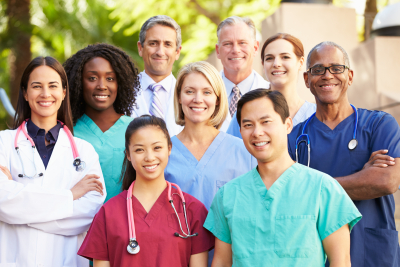 multiracial staff smiling